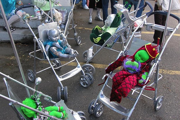 Alien Babies by DuncanCV. Green and silver dollies in children's buggies.