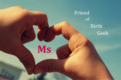 Fingers held in shape of a heart against a blue sky background with 'Ms Friend of Birth Geek' scattered across